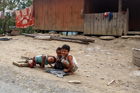 western state: CHIN STATE, MYANMAR - JUNE 16 2015: Children play in the street of a village in the recently opened to foreigners area of Chin State - western Myanmar (Burma)