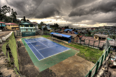 foreigners: HAKHA, MYANMAR - JUNE 19 2015: Tennis arena in remote town of Hakha in the recently opened to foreigners area of Chin State - western Myanmar (Burma) Editorial