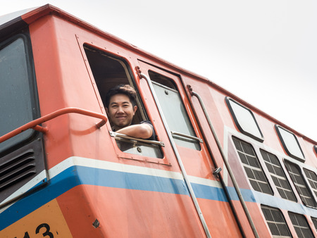 hottest: MAE TAN NOI, THAILAND - MARCH 22 2015: Train Driver at remote train station Mae Tan Noi on one of the hottest recorded days in Northern Thailand.
