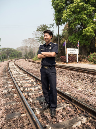 route master: MAE TAN NOI, THAILAND - MARCH 22 2015: Tain Master in natural train station Mae Tan Noi on one of the hottest recorded days in Northern Thailand.