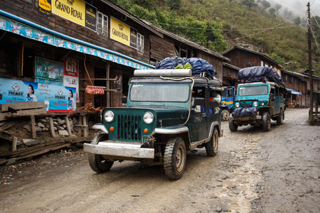 western state: CHIN STATE, MYANMAR - JUNE 23 2015: Trucks in village popular for selling apples in the recently opened to foreigners area of Chin State - western Myanmar (Burma)