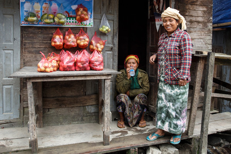 western state: CHIN STATE, MYANMAR - JUNE 23 2015: Ladies selling apples in the recently opened to foreigners area of Chin State - western Myanmar (Burma)