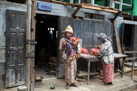 western state: CHIN STATE, MYANMAR - JUNE 23 2015: Village popular for selling apples in the recently opened to foreigners area of Chin State - western Myanmar (Burma)