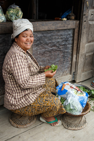 western state: CHIN STATE, MYANMAR - JUNE 23 2015: Preparing vegetables in village in the recently opened to foreigners area of Chin State - western Myanmar (Burma)
