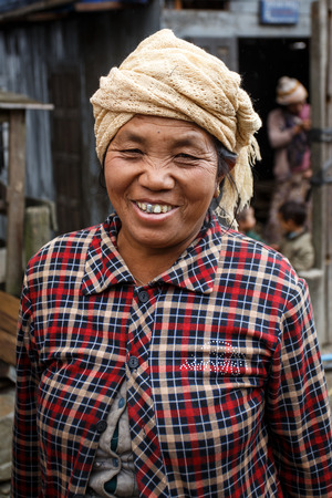 western state: CHIN STATE, MYANMAR - JUNE 23 2015: Friendly lady in village popular for selling apples in the recently opened to foreigners area of Chin State - western Myanmar (Burma)