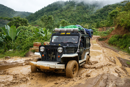 CHIN STATE, MYANMAR - JUNE 22 2015: Offroad Adventure on Dirt Road Leading Through Chin State Mountainous Region, Myanmar (Burma) Editorial