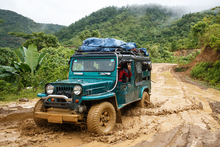 mountainous: CHIN STATE, MYANMAR - JUNE 22 2015: Offroad Adventure on Dirt Road Leading Through Chin State Mountainous Region, Myanmar (Burma) Editorial