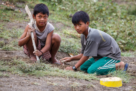 CHIN STATE, MYANMAR - JUNE 22 2015: Local village boys in the recently opened for tourists Chin State Mountainous Region, Myanmar (Burma)