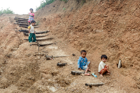 foreigners: FALAM, MYANMAR - JUNE 17 2015: Local children in the recently opened to foreigners area of Chin State - western Myanmar (Burma) Editorial