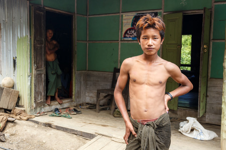foreigners: FALAM, MYANMAR - JUNE 17 2015: Local young man in the recently opened to foreigners area of Chin State - western Myanmar (Burma)