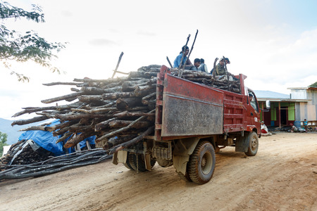forestry: FALAM, MYANMAR - JUNE 22 2015: Forestry truck on dirt road in the recently opened to foreigners area of Chin State - western Myanmar (Burma)
