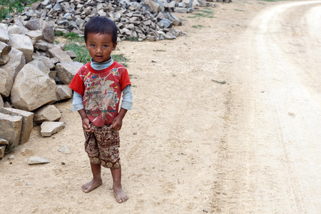 recently: FALAM, MYANMAR - JUNE 17 2015: Local child in the recently opened to foreigners area of Chin State - western Myanmar (Burma)