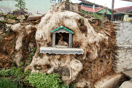 foreigners: Shrine inside a tree in Falam in the recently opened to foreigners area of Chin State - western Myanmar (Burma)