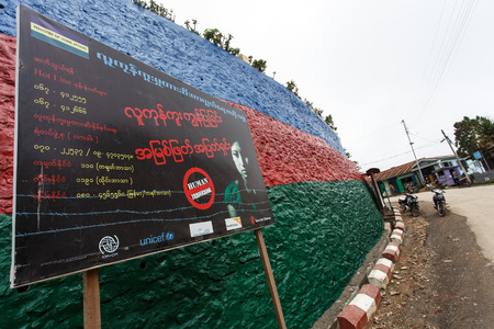 trafficking: FALAM, MYANMAR - JUNE 18 2015: Human Trafficking sign in Falam Town in the recently opened to foreigners area of Chin State - western Myanmar (Burma)