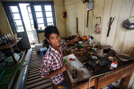 skilled: CHIN STATE, MYANMAR - JUNE 18 2015: Skilled metal work in the recently opened for tourists Chin State Mountainous Region, Myanmar (Burma)