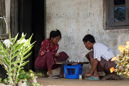 passtime: CHIN STATE, MYANMAR - JUNE 18 2015: Local people playing chess in the recently opened for tourists Chin State Mountainous Region, Myanmar (Burma)