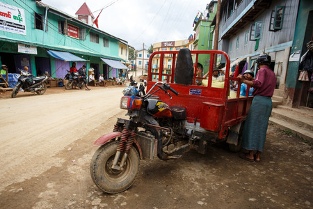 adapted: CHIN STATE, MYANMAR - JUNE 18 2015: Motorbike adapted goods vehicle in the recently opened for tourists Chin State Mountainous Region, Myanmar (Burma)