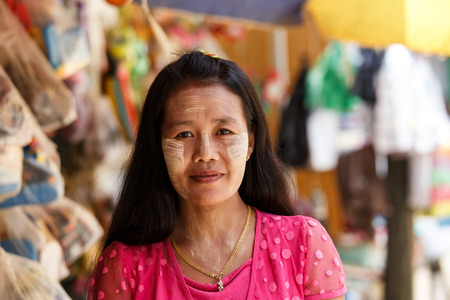 thanaka: CHIN STATE, MYANMAR - JUNE 18 2015: Beautiful lady with thanaka painted face in the recently opened for tourists Chin State Mountainous Region, Myanmar (Burma)