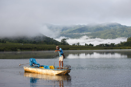 RHI LAKE, MYANMAR - JUNE 21 2015: Local fisherman on the daily fishing trip at the start of the monsoon season in the recently opened to tourists Chin State region of Western Myanmar (Burma)