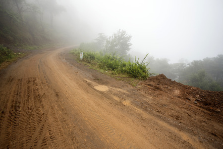 chin: Misty Road Leading Through Chin State Mountains, Myanmar