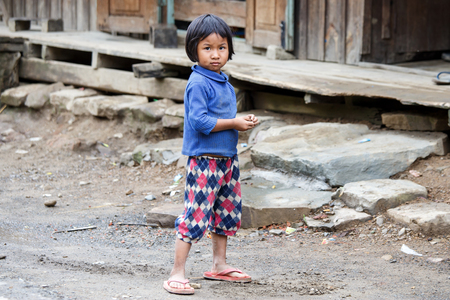 chins: HAKHA, MYANMAR - JUNE 19 2015: Local girl in the Hakha region in Chin State, Myanmar.