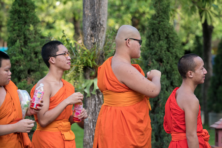 reigning: CHIN STATE, THAILAND - OCTOBER 15 2016: Young buddhist monks mourn the death of their King - Bhumibol Adulyadej (the longest reigning monarch in the world), Chiang Mai, Thailand Editorial