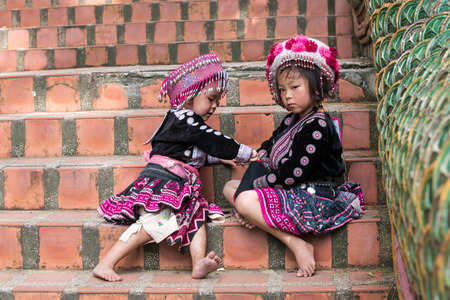 reigning: CHIN STATE, THAILAND - OCTOBER 15 2016: Children on the steps of Wat Doi Suthep in mourning the death of their King - Bhumibol Adulyadej (the longest reigning monarch in the world), Chiang Mai, Thailand