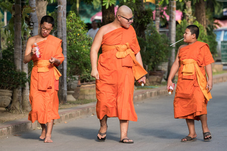 CHIN STATE, THAILAND - OCTOBER 15 2016: Young buddhist monks mourn the death of their King - Bhumibol Adulyadej (the longest reigning monarch in the world), Chiang Mai, Thailand Editorial