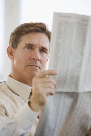 financial newspaper: Business man reading financial newspaper