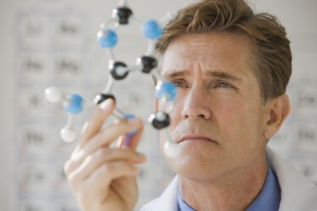 Scientist with DNA molecule photo