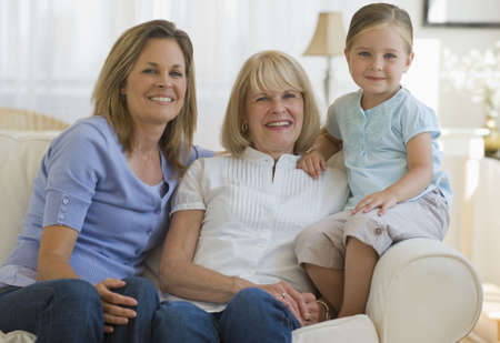 Three generations sitting on couch photo
