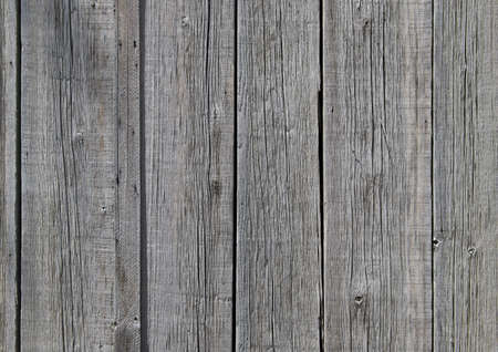 horizontally: Close-up shot of wooden planks on the side of a building.  Horizontally framed shot.