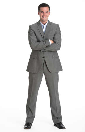 A young man is wearing a business suit and smiling at the camera.  Vertically framed shot. Stock Photo - 5371765
