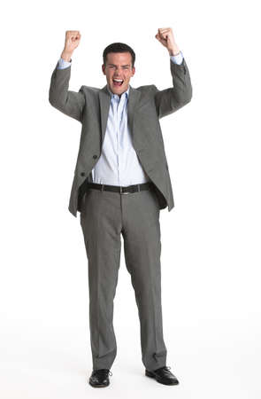 midlife: An attractive businessman cheering with his fists in the air.  Vertically framed shot. Stock Photo