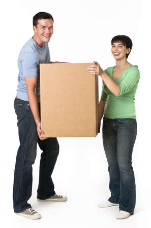 blue box: A happy and attractive young couple holding a cardboard box together.  They are smiling and are looking directly at the camera.  Vertically framed shot.