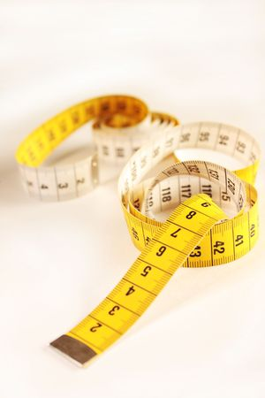 metering: Close up of a yellow measuring tape