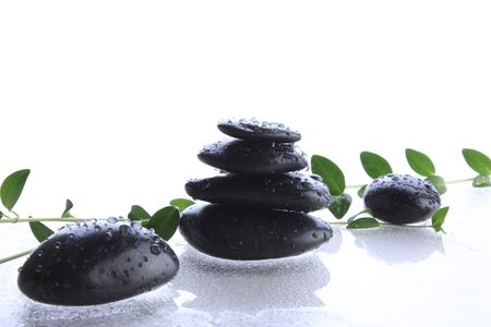 Black  spa stones on wet surface