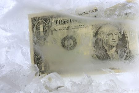 Frozen dollar in a block of ice Stock Photo