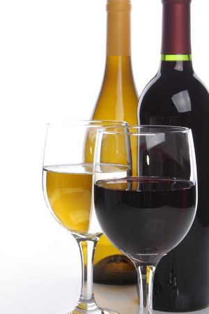 White and red wine bottles with two glasses photo