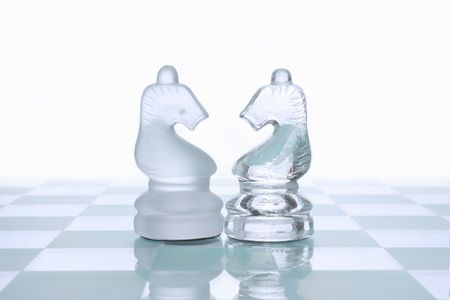 chess board: Glass chess figures on board