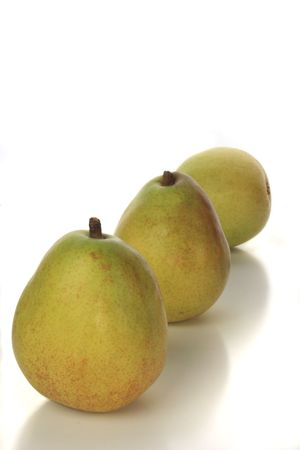 Delicious green and yellow pears isolated on white Stock Photo