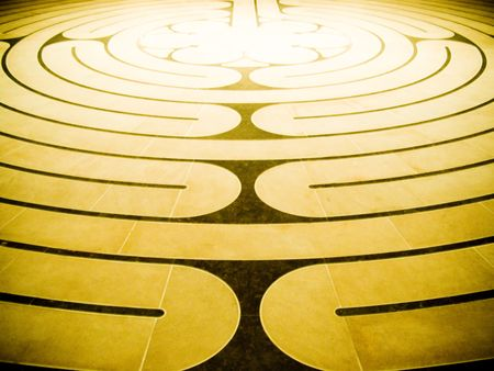 Brown and golden spiral maze floor pattern