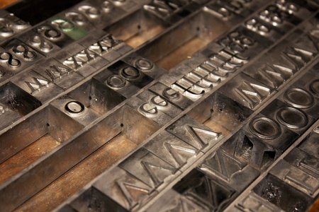 Lead letterpress alphabet arranged in a drawer Stock Photo
