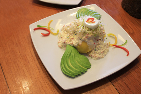 Decorated Crab Salad with avocado and potatoes
