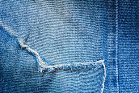 古いブルー ・ ジーンズにクローズ アップ涙 写真素材
