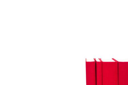 白い背景で隔離赤いハードカバーの本 写真素材