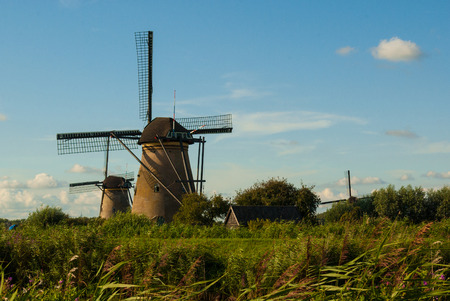 windmills: Windmills in Kinderdijk - Holland Stock Photo