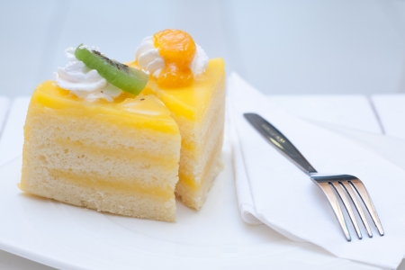 Orange cake toping with fruit photo