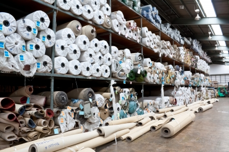 cloth manufacturing: Carpet warehouse Stock Photo