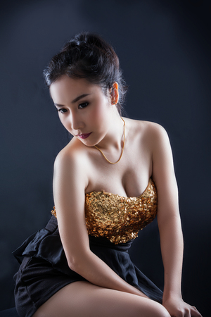 sexy black woman: Portrait of beautiful Asian young girl on black background Stock Photo